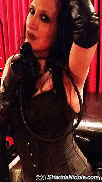 Mistress Sharina Nicole with whip