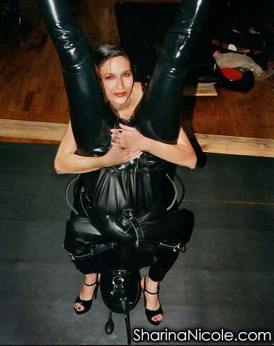 Dominatrix Mistress Sharina Nicole puts her latex rubber slave kitty in his latex cat suit with strict rubber straight jacket bondage & inversion play